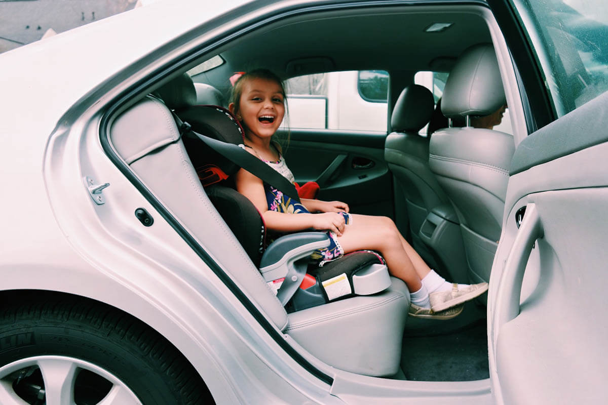kid in car seat child safety laws