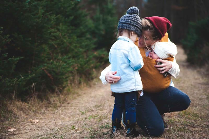 mom hugs child
